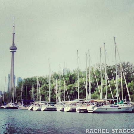 view of cn tower from toronto islands yacht club