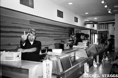 kome sushi co-owner take at sushi bar