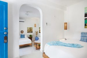 Room 1: This room features two double beds and its own patio with table and chairs. One bath with shower. Air conditioning. Seating area. Hammock in the room! High ceilings in the lower bedroom area.