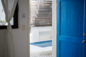 Room 2: This room features two double beds and a seating area. One bath with shower. Air conditioning. Hammock in the room!