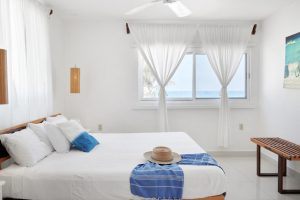 Room 3: This room features a king bed and a view of the Caribbean Sea. Small front porch seating area with sea view featuring two chairs. One bath with shower. Inside seating area. Air conditioning. Hammock in the room!